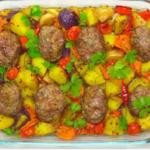 Мясные котлеты с овощами в духовке